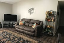 Living room space for guests to relax. We have Direct TV and you can also request a DVD to watch.