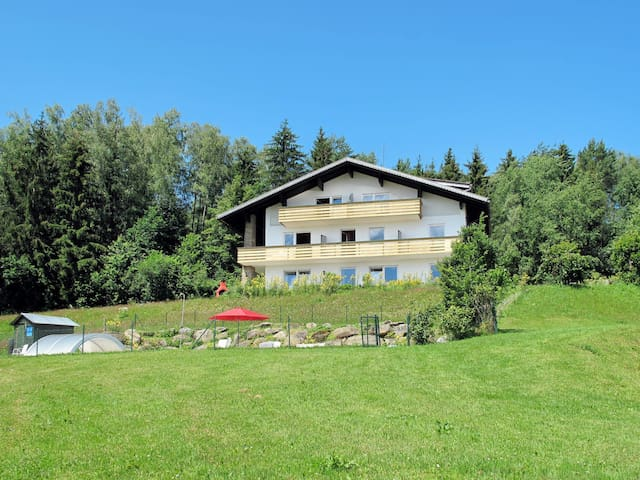 Spacious, well-designed holiday home in a hillside location with stunning views of the valley and surrounding mountains