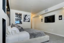 """Bedroom with 55"""" TV"""