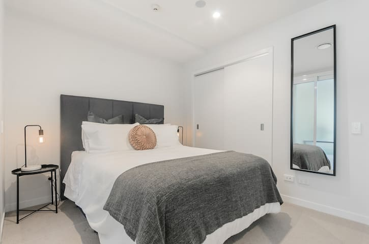Master Bedroom with a Queen Size Bed and cupboard space