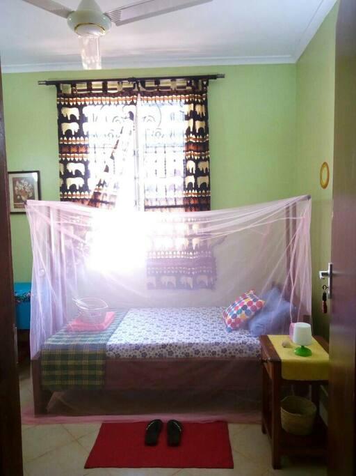 Single room at Mulungu's Love Home.