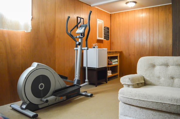 An elliptical is in the room. You can use it while staying at our place. They're also a couple of gyms nearby if you prefer a more updated workout during your stay.