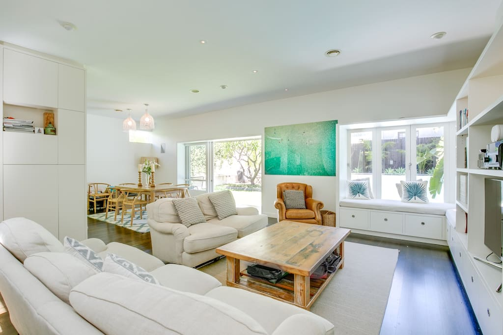 Spacious living area opening to pool and garden