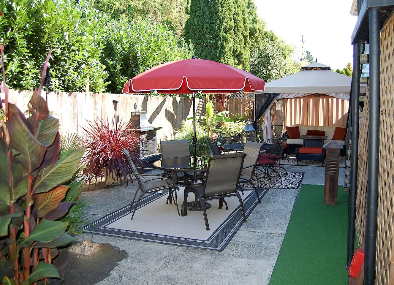 Private back patio with outdoor fire place, gazebo, gas fire table, gas BBQ, and more...