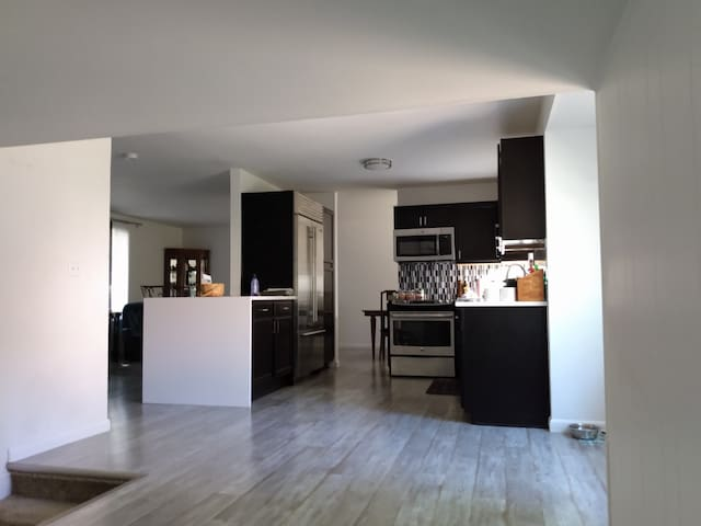 Main level kitchen leading to living and dining areas.
