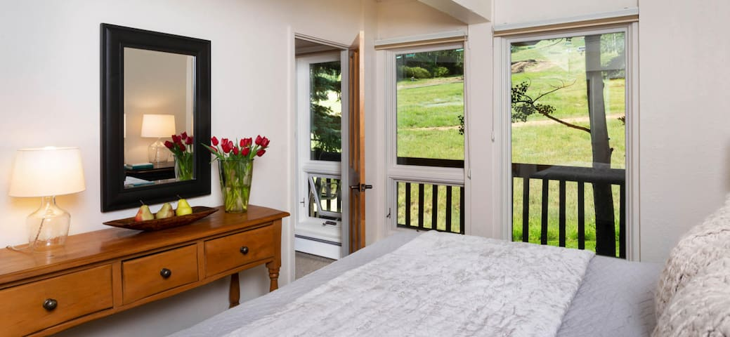 Master bedroom.     Master suite  w/private bathroom/shower      Oh the view from the bed is delightful!  Love to relax and watch the ski people and hikers go by.    At night its fun to see the groomers and snowcats go by as well.