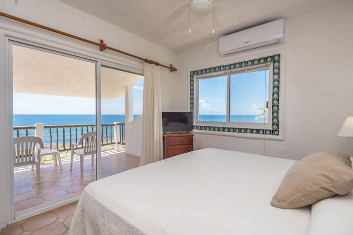 Master bedroom with a king bed, private terrace, and bathroom with shower.