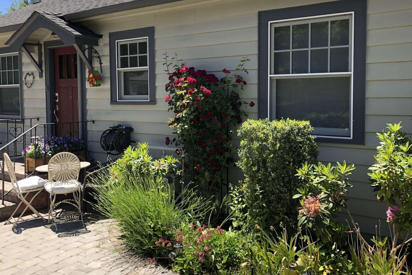 Beautifully landscaped, the home is surrounded by colorful perennials.