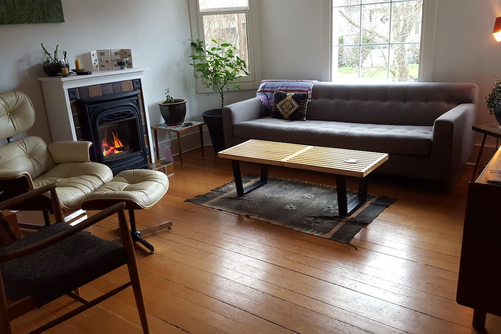 Sunny living room.  Fireplace keeps the space cozy in the wintertime.