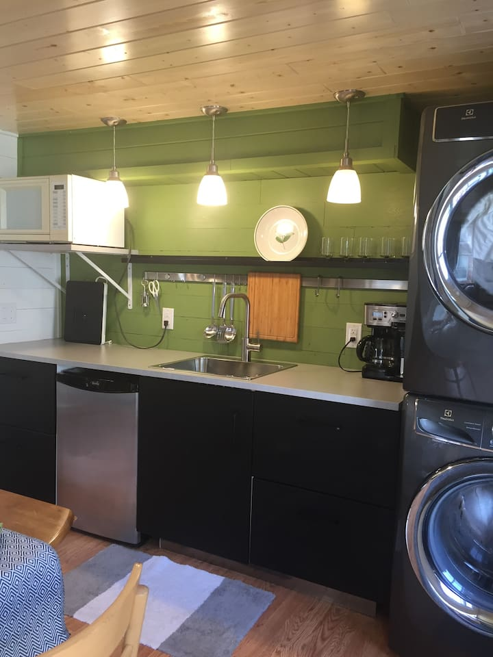 This kitchen was a fun project using 10 feet to include an under-counter refrigerator, washer/dryer, microwave, sink, coffee pot and induction cooktop for one pot at a time.  It works! but I would not plan four-course meals..