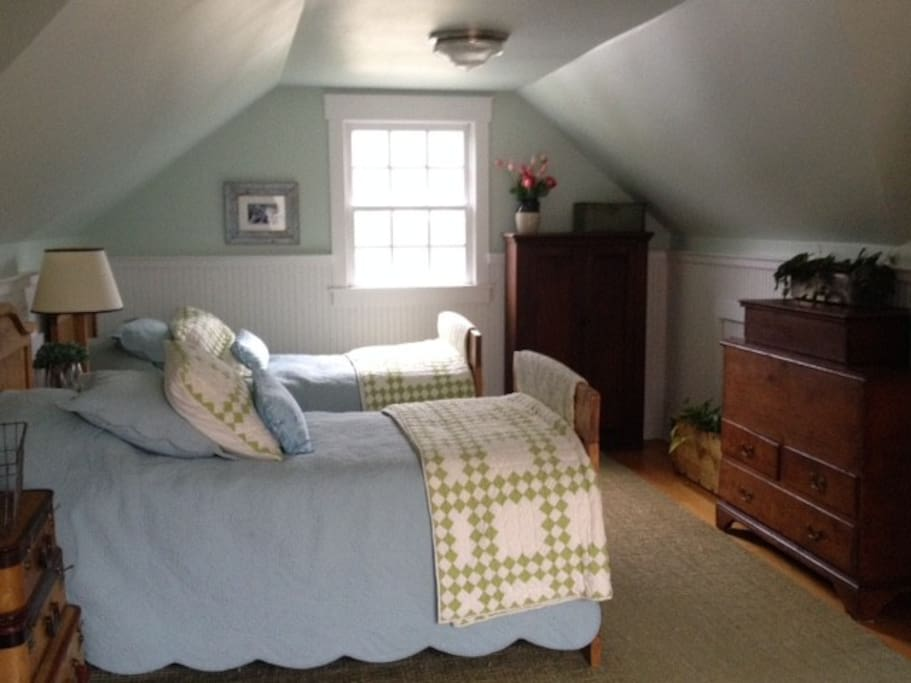 Another photo of the light-filled guest bedroom.