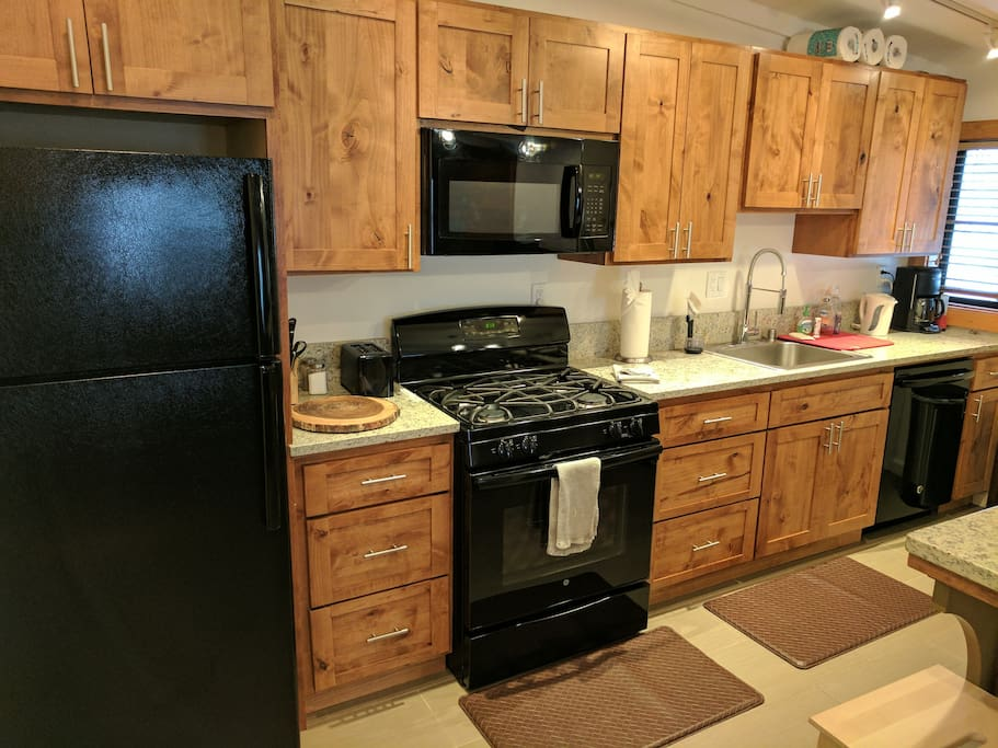 modern kitchen with gas stove / dishwasher