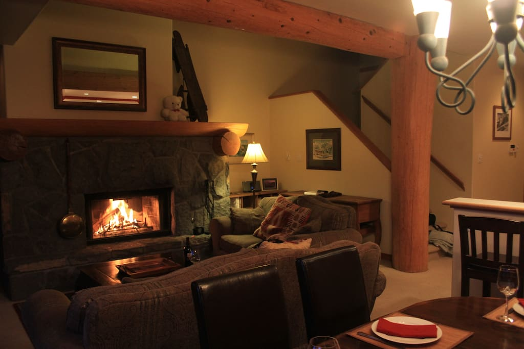 Relax in front of a lodge size wood burning fireplace