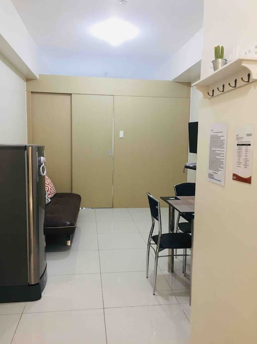 One bedroom condo unit with living and dining areas