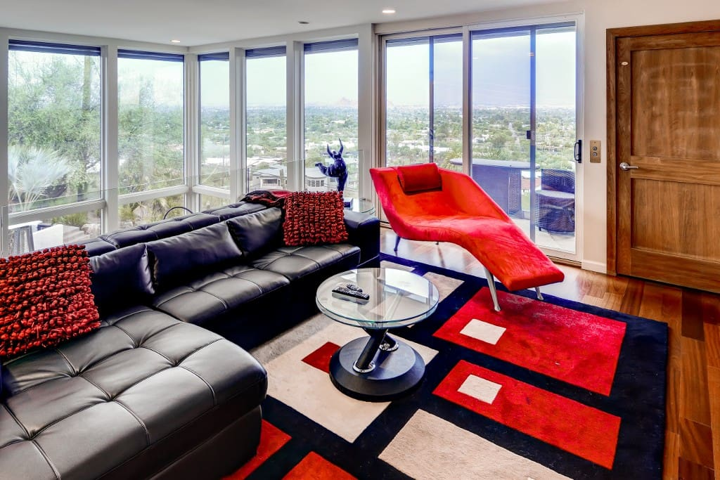 Plush furnishings and vibrant pops of color abound throughout this home's modern interior.