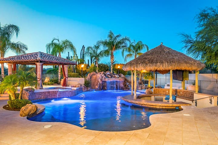 NEW LISTING! Luxury home with pool and spa, swim up bar, theater room and more!