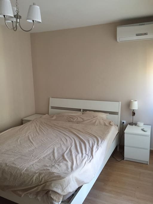 Large bedroom with double bed and air conditioner