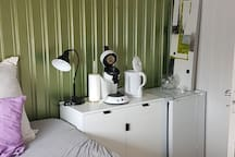 Refrigerator, kettle and coffee machine in the room. The bed is 150 wide.