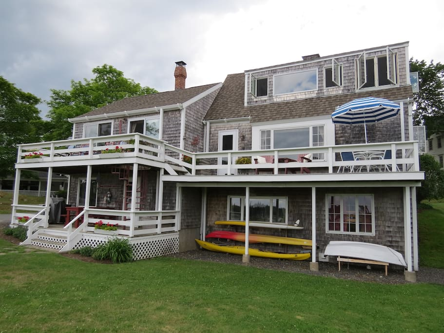 Multiple decks. Kayaks, Paddleboard, row boat for guest use. (free)