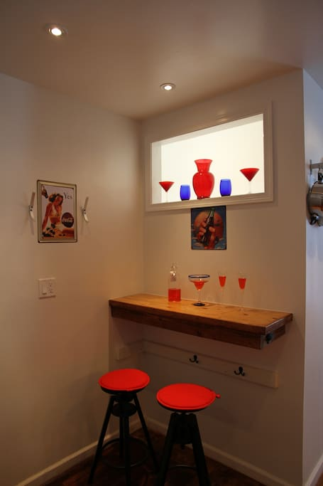 Bar with with two stools as a USB work station or relax with a drink
