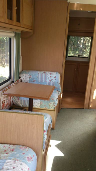 Daisy Caravan - Table and seats fold back to 2 small bunk beds for children.