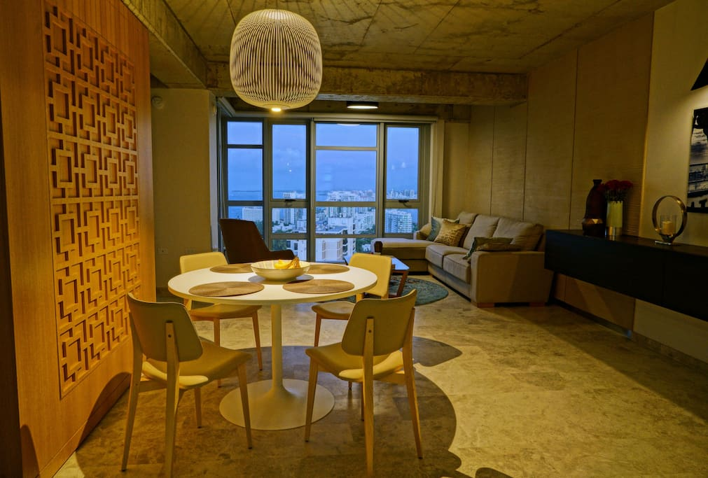 Custom designer builtin furnishings add to the tasteful decor which amply frames the view from the 23rd floor looking out to the Condado and San Juan