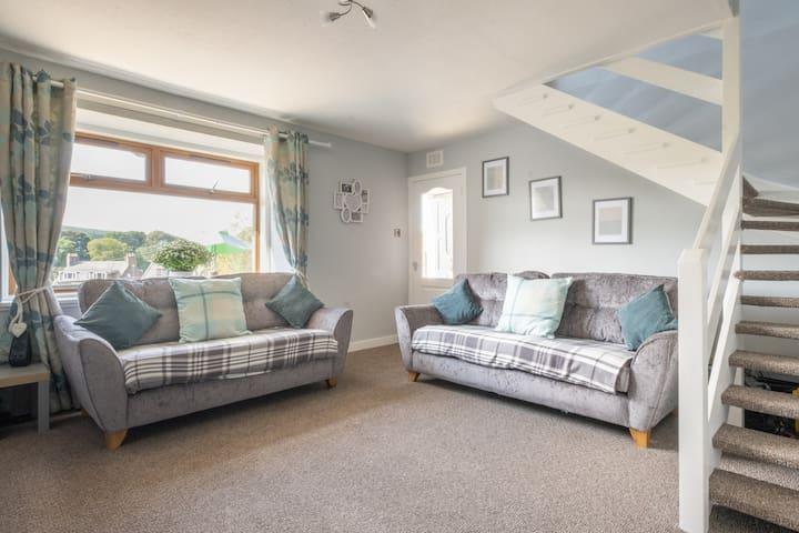 Light and spacious living room for everyone to relax and feel comfortable with gas central heating. Lovely views from the window. There is BT complete wifi and Netflix to enjoy.
