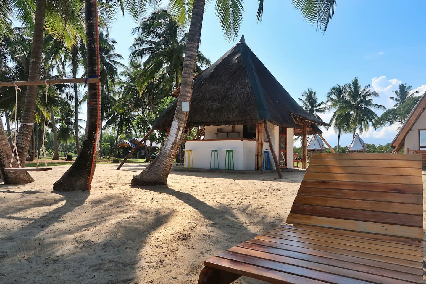 Get under the sun and lounge by the beach.