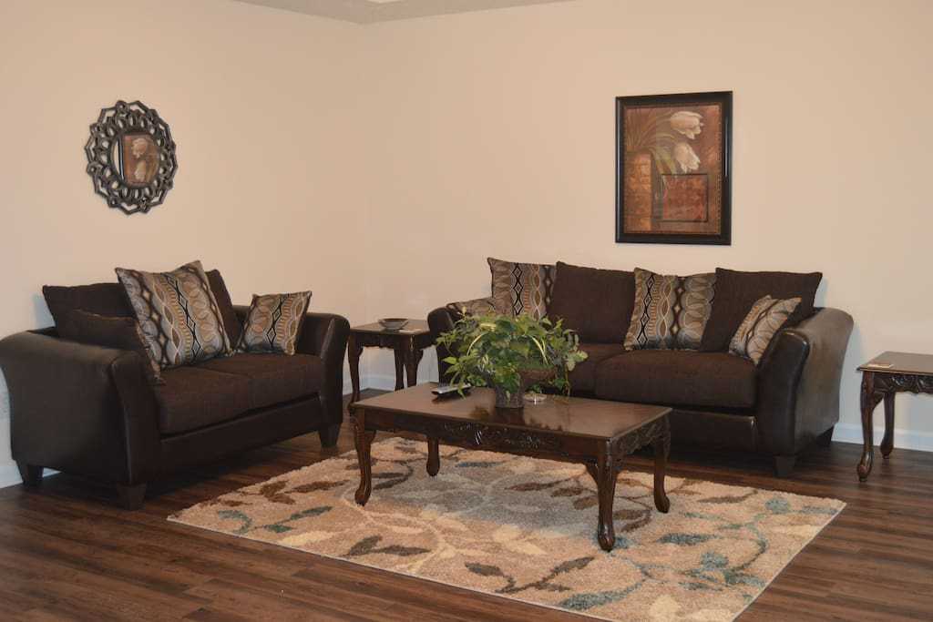 Comfortable living room with flat screen TV.