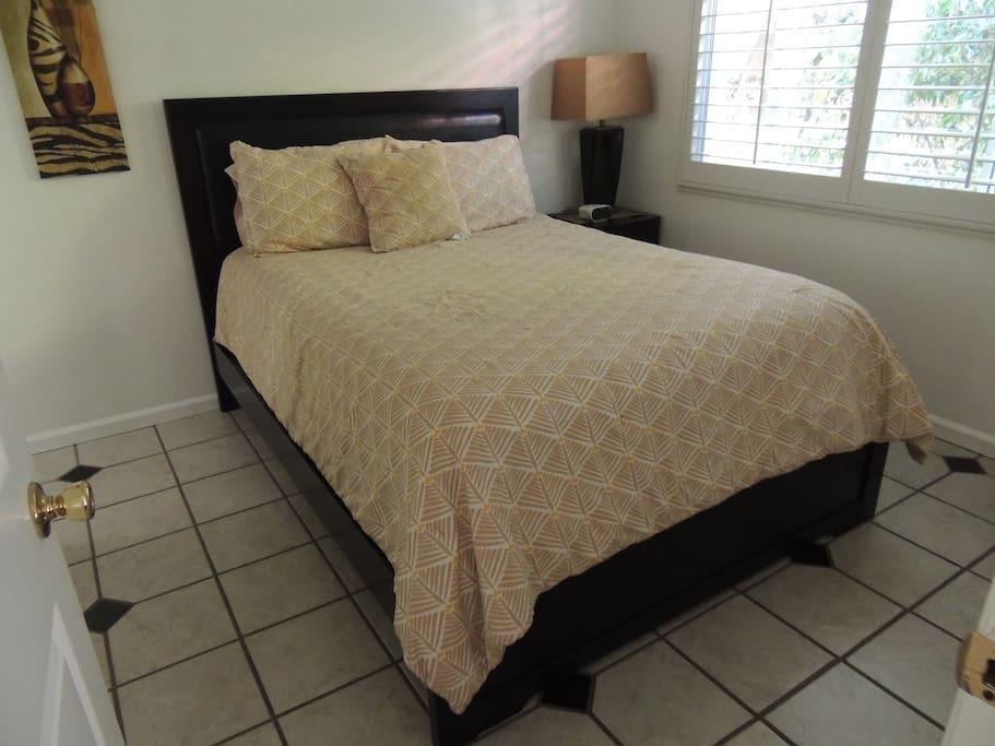 One of three Queen beds