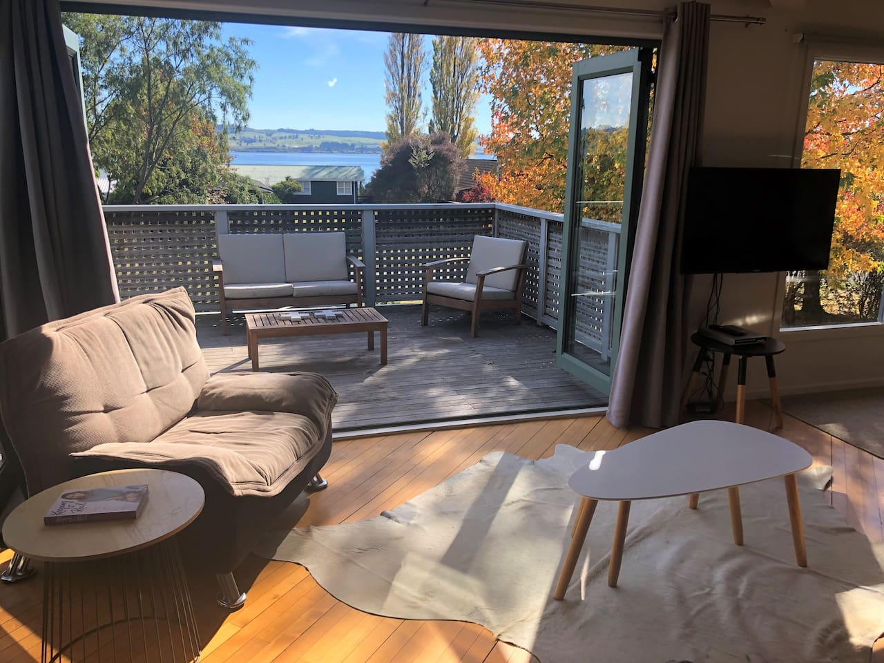 Living area opens out to the deck overlooking the lake
