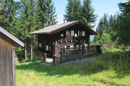 Lovely rustic wooden chalet in idyllic location, in the middle of a hiking area