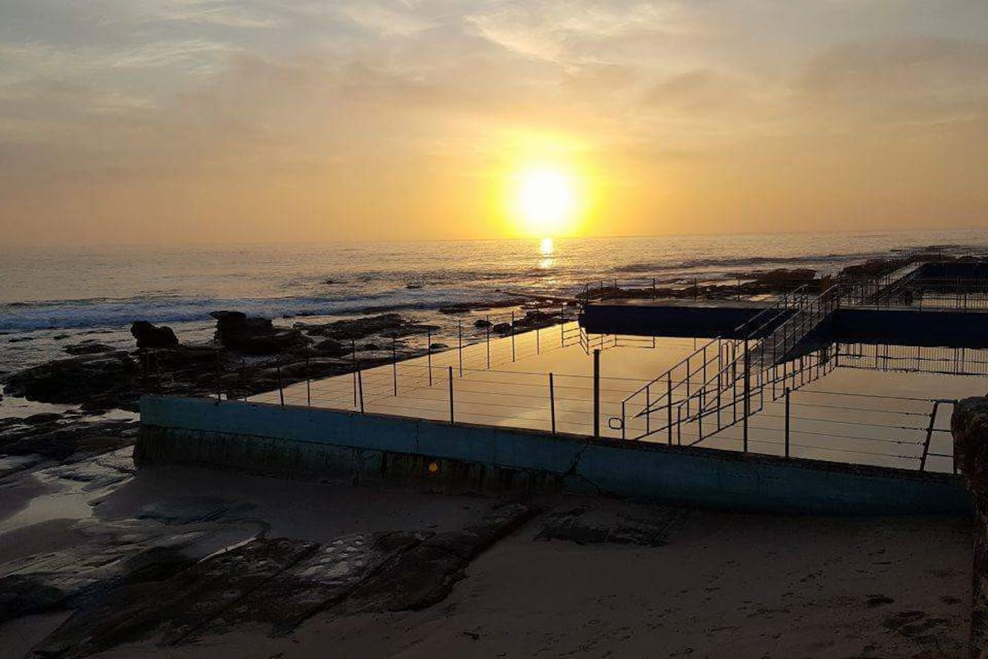 Sunrise over The Entrance Baths. 2 small pools and an Olympic size pool for laps...or just go surfing!