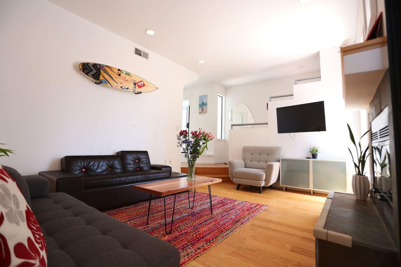 Living room with TV, DVD player, gas fireplace, designer sofa