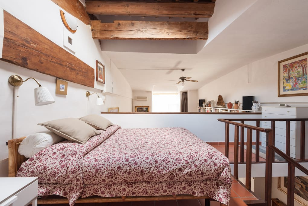 view of the bedroom with exposed beams