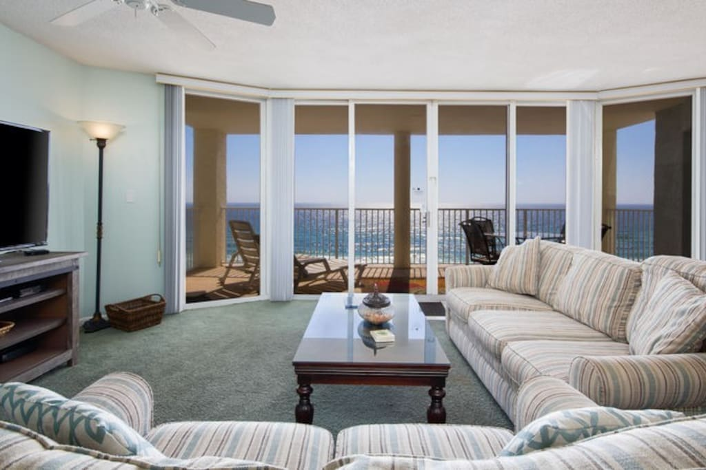 The Living Room Has Lots of Natural Light from the Floor to Ceiling Sliding Glass Doors