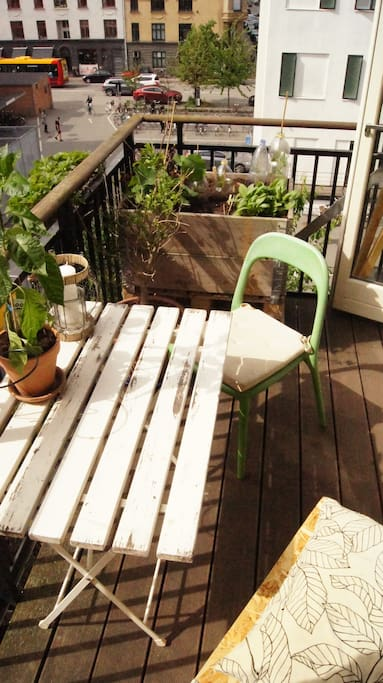 Balcony with outdoor furniture and plants