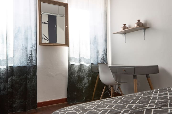 Bedroom area complete with a modern study desk that completes this ideal working space