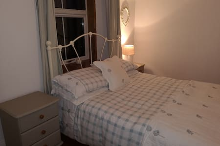 A stylish and comfortable double bedroom with en suite bathroom