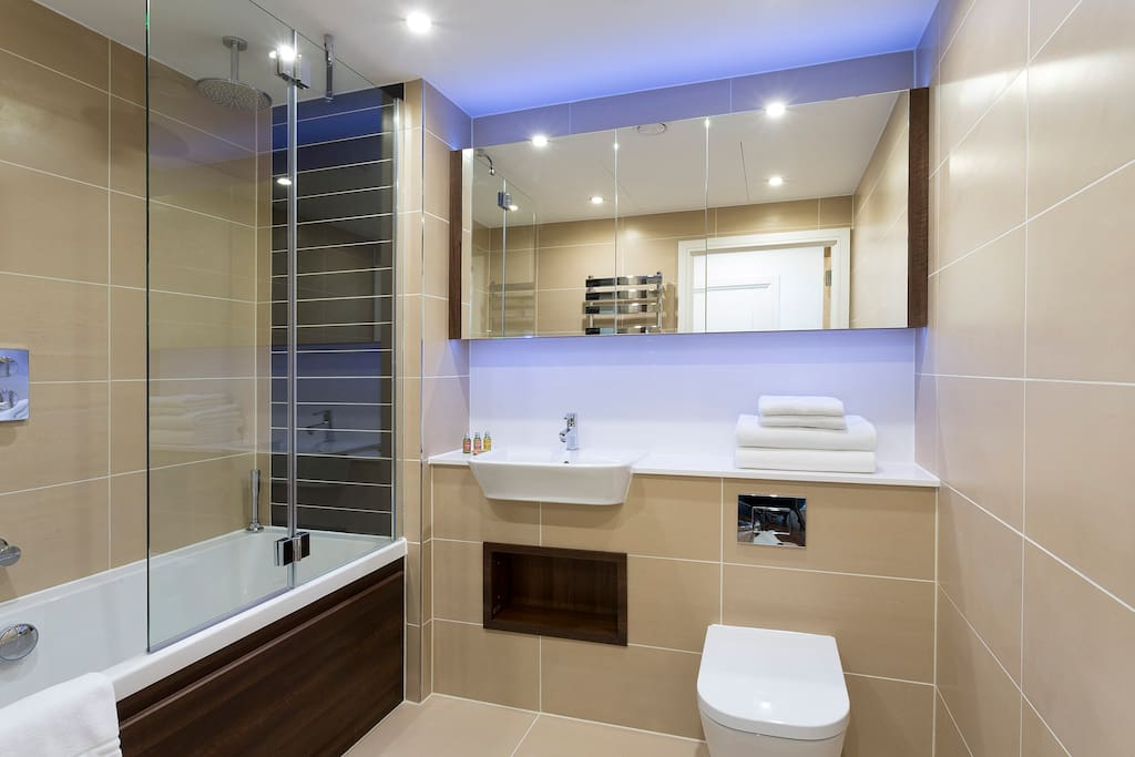 Spotless Bathroom with designer toiletries and power shower