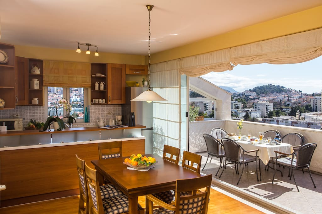 Dining area with a view of the kitchen sunbathing in natural sunlight