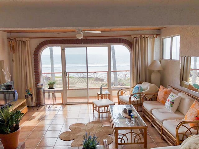 Sit in the living room with family and friends while enjoying a breathtaking view of the Pacific Ocean.