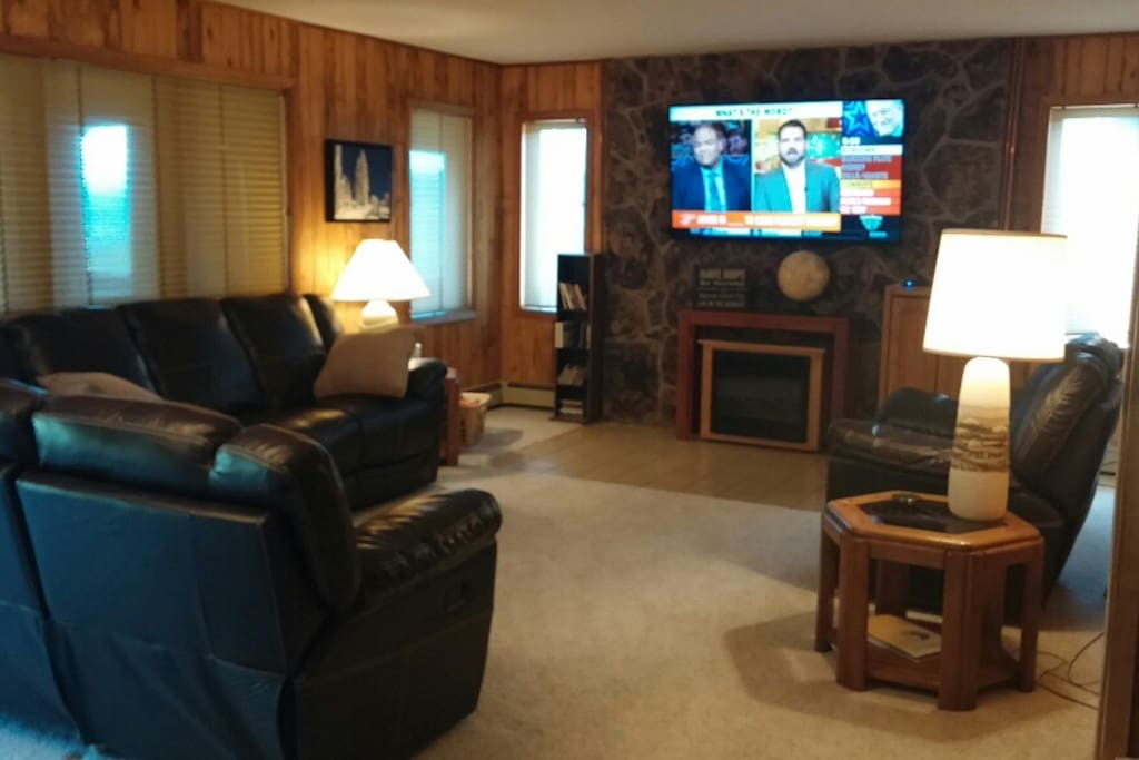 """65"""" Screen with DirecTV in Upper level living room"""