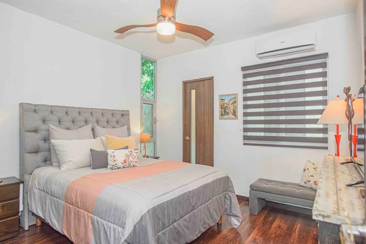 Queen bedroom on the lower level includes Roku TV, a large closet and an en suite