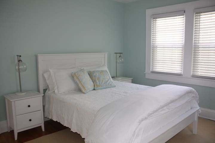Queen bedroom #2 with plush linens and flat screen TV