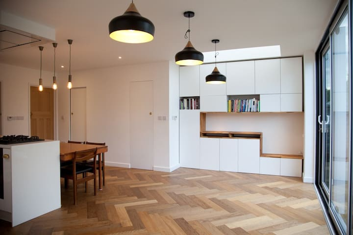 Modern, bright and light end of terrace house.