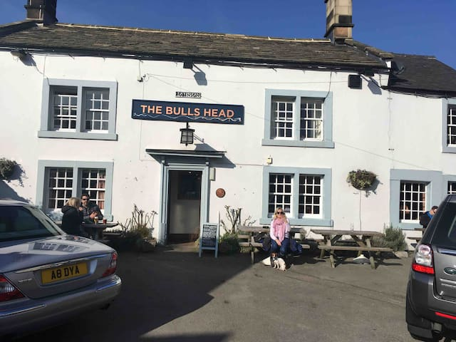 Sarah and Titch outside The Bulls Head in Feb 15 degrees - This is a 15 minute walk along the River Wye from our house and does great food and has a lovely atmosphere. Beer garden is set next to the park, has a boule track and is an evening sun trap.