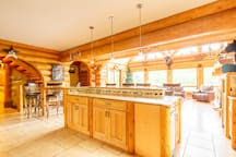 Huge windows light up this home, and flow from living room thru dinning room, along with all great relaxing furniture,