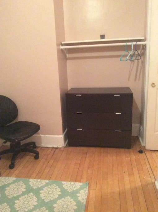 This is the closet with a set a drawers and a desk chair. Working on getting a desk soon!
