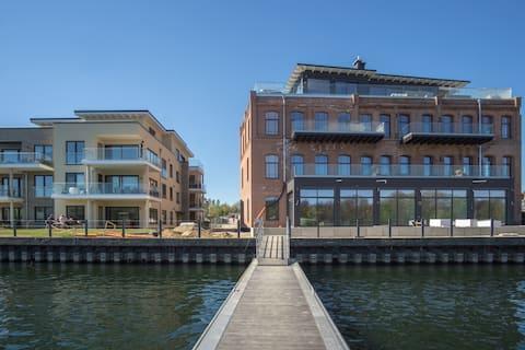 Moderne Wohnung im Loft-Stil direkt am See